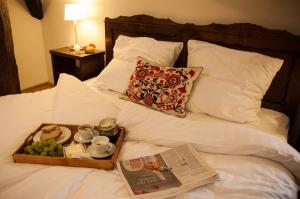 A bed or beds in a room at Transylvania Guesthouses