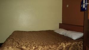 A bed or beds in a room at Hopewell Guest House