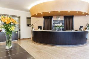 The lobby or reception area at Hotel Des Etrangers