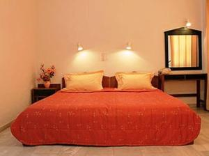 A bed or beds in a room at Calypso Hotel Apartments