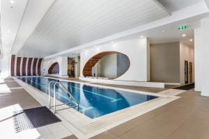 The swimming pool at or near Complete Host Vogue Apartments