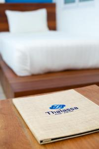 A bed or beds in a room at Thalassa