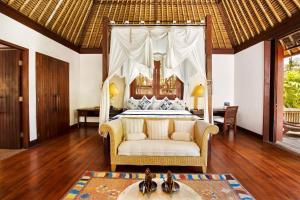 A seating area at The Oberoi Beach Resort, Lombok