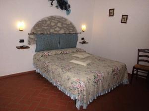 Letto o letti in una camera di Agriturismo La Castellina