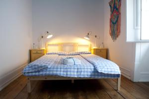 A bed or beds in a room at Atlas Hostel Leiria