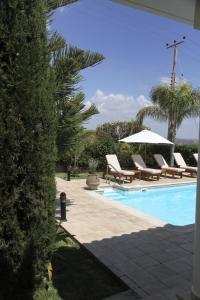 The swimming pool at or near Eve Pissouri Veriko Villa