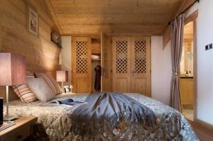 Un ou plusieurs lits dans un hébergement de l'établissement CGH Résidences & Spas Le Village De Lessy