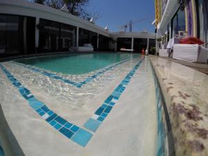 The swimming pool at or near Villa das Arábias Boutique Hotel
