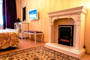 Телевизор и/или развлекательный центр в Apartment Choomichova
