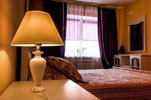 Кровать или кровати в номере Apartment Choomichova