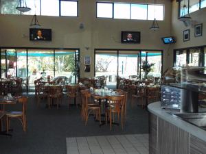 A restaurant or other place to eat at Bushland Beach Tavern