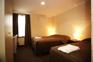 A bed or beds in a room at Prince of Wales Hotel, Bunbury