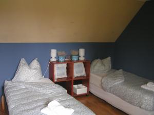 Een bed of bedden in een kamer bij B&B aandedijkinbrakel