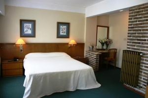 A bed or beds in a room at Hotel Rosario