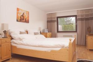 Ein Bett oder Betten in einem Zimmer der Unterkunft MS Wiese Apartment