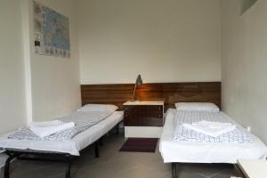 Ein Bett oder Betten in einem Zimmer der Unterkunft A1FLATS