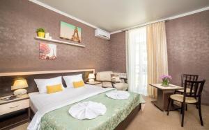 Кровать или кровати в номере Milotel Margarita