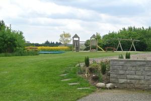 En have udenfor Fitting Landsbyferie Apartments