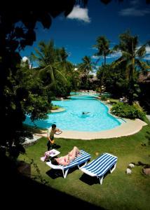 The swimming pool at or near Bluewater Maribago Beach Resort
