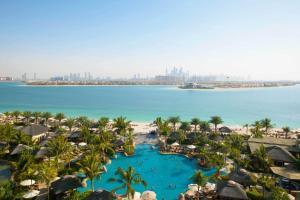 A view of the pool at Sofitel Dubai Palm Apartments or nearby