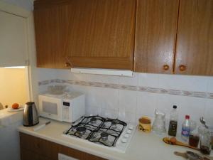 A kitchen or kitchenette at Jardin Calpe Apartment