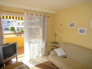 A television and/or entertainment center at Jardin Calpe Apartment