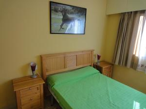 A bed or beds in a room at Jardin Calpe Apartment