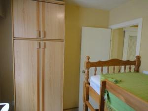 A bunk bed or bunk beds in a room at Jardin Calpe Apartment
