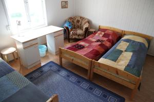A bed or beds in a room at Opintola Bed & Breakfast