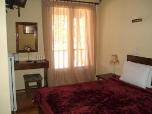 Ένα ή περισσότερα κρεβάτια σε δωμάτιο στο Ξενώνας Σινόη