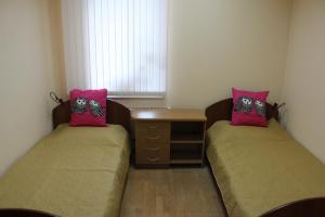 Кровать или кровати в номере Хостел Сова