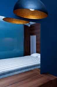 A bed or beds in a room at Frideriki Studios & Apartments