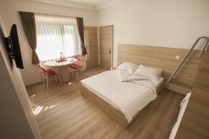 A bed or beds in a room at Sweet Dreams Rooms and Apartments Postojna