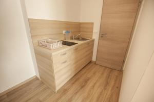 A kitchen or kitchenette at Sweet Dreams Rooms and Apartments Postojna