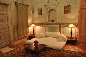 A seating area at Hotel Chobdar Haveli
