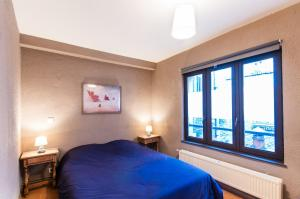 A bed or beds in a room at Zen Appart Vieux Lille 2