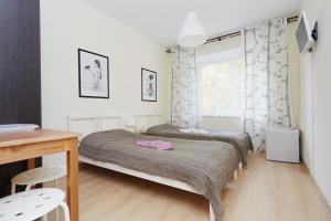 Кровать или кровати в номере Зона Сна на Студенческой