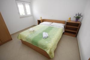 Postel nebo postele na pokoji v ubytování Apartments Neva