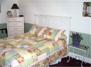 A bed or beds in a room at Buffalo Pointe Inn