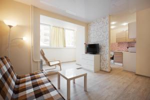 Гостиная зона в Apartment ot Nadezhdy Uchebnaya