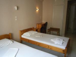 Кровать или кровати в номере Atlantis Hotel