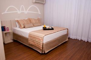 A bed or beds in a room at Hotel Mercure Brasília Líder