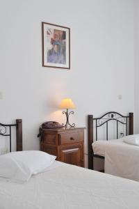 Säng eller sängar i ett rum på Eri Hotel