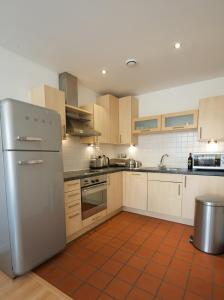 A kitchen or kitchenette at Stay Deansgate Apartments for 14 nights plus