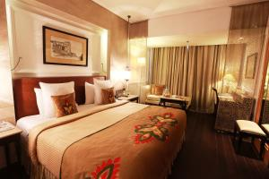 A bed or beds in a room at The Ashok, New Delhi