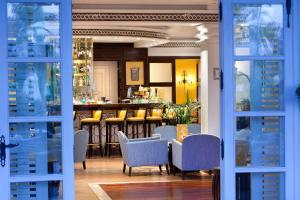 A restaurant or other place to eat at Seaside Grand Hotel Residencia - Gran Lujo