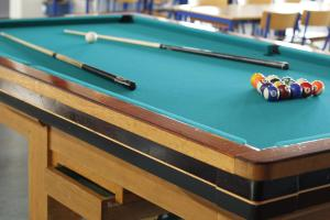 A pool table at 62N Guesthouse Marknagil
