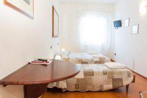Кровать или кровати в номере Alloggio Cavour