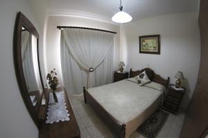 A bed or beds in a room at Eve Pissouri Xιnisteri Villa