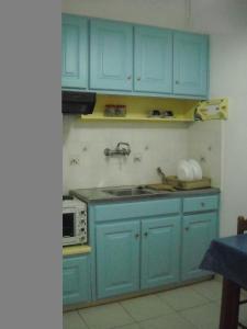 Η κουζίνα ή μικρή κουζίνα στο Maritsas Apartments